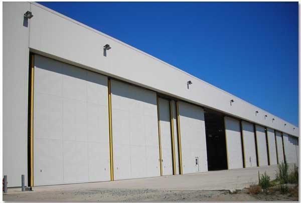 Brochures & Hangar Doors bottom rolling top-guided hangar doors Canopy ... pezcame.com